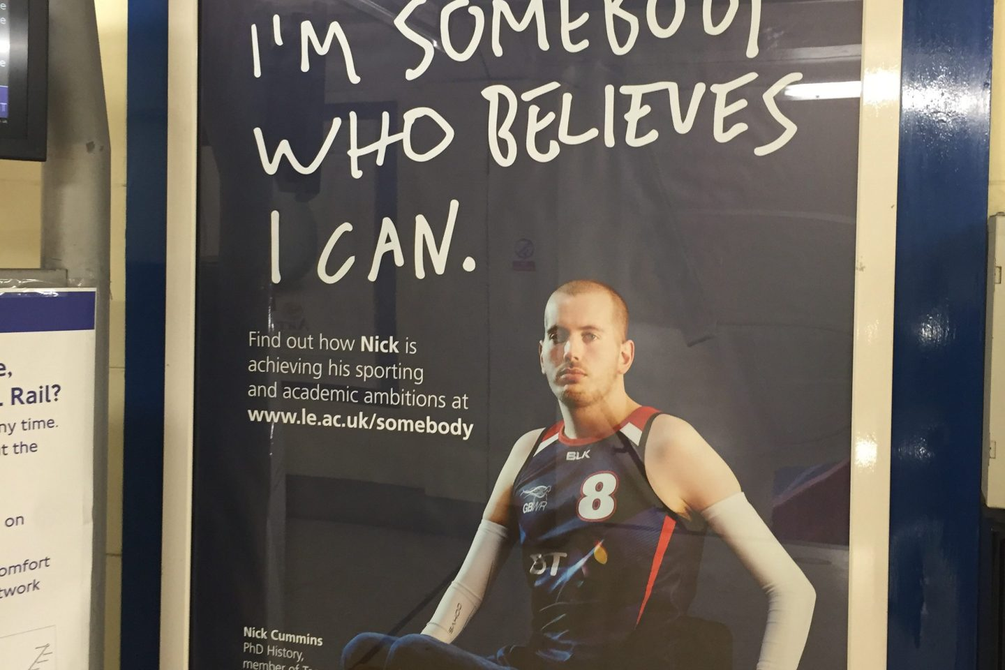 "Promotional poster showing of a young man in a wheelchair with the caption ""I'm somebody who believes I can"""