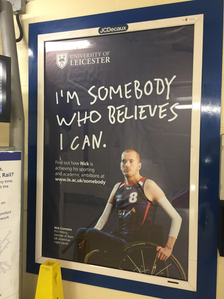 """Promotional poster showing of a young man in a wheelchair with the caption """"I'm somebody who believes I can"""""""